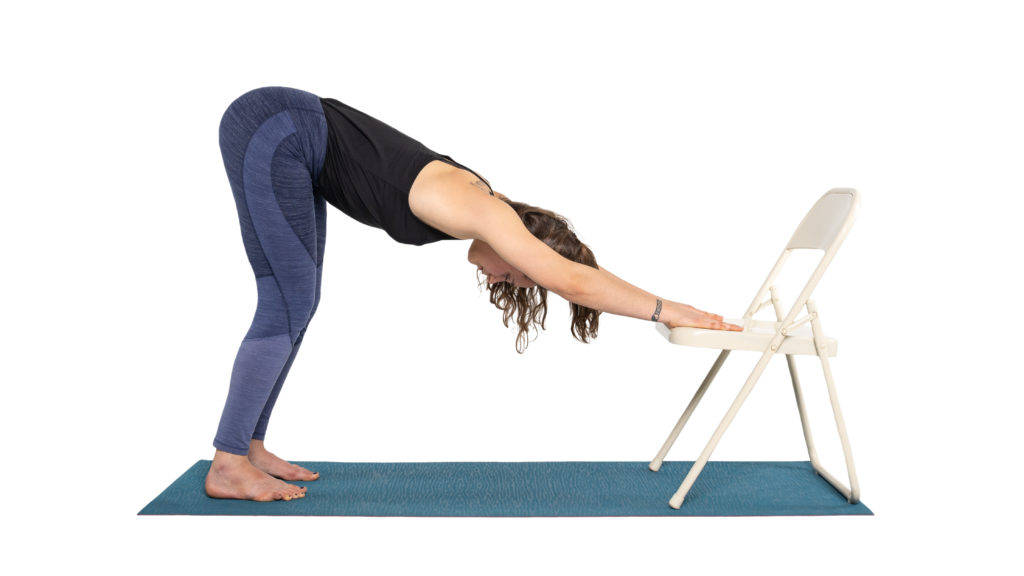Downward facing Dog Pose with a chair as a yoga prop, pose variations
