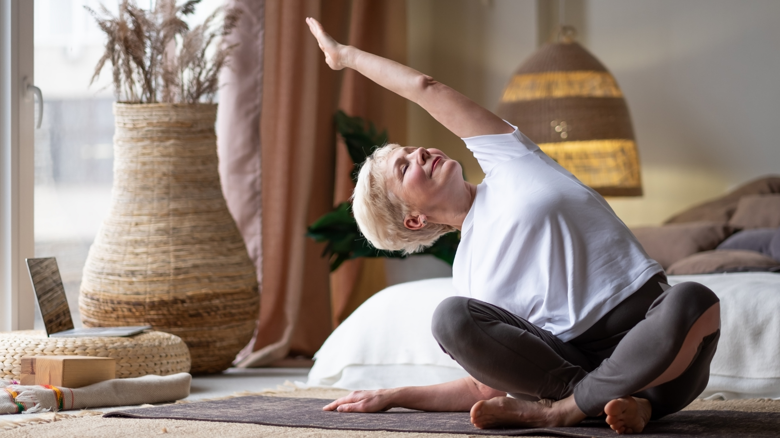 Yoga student practicing a grounding and releasing practice for grief in Easy Pose (Sukhasana)