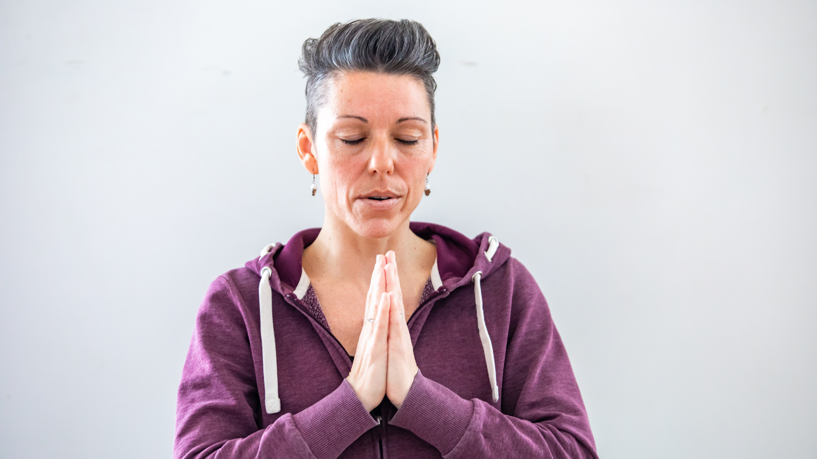 Yoga student experiencing the benefits of connecting the mind and body through the power of the breath