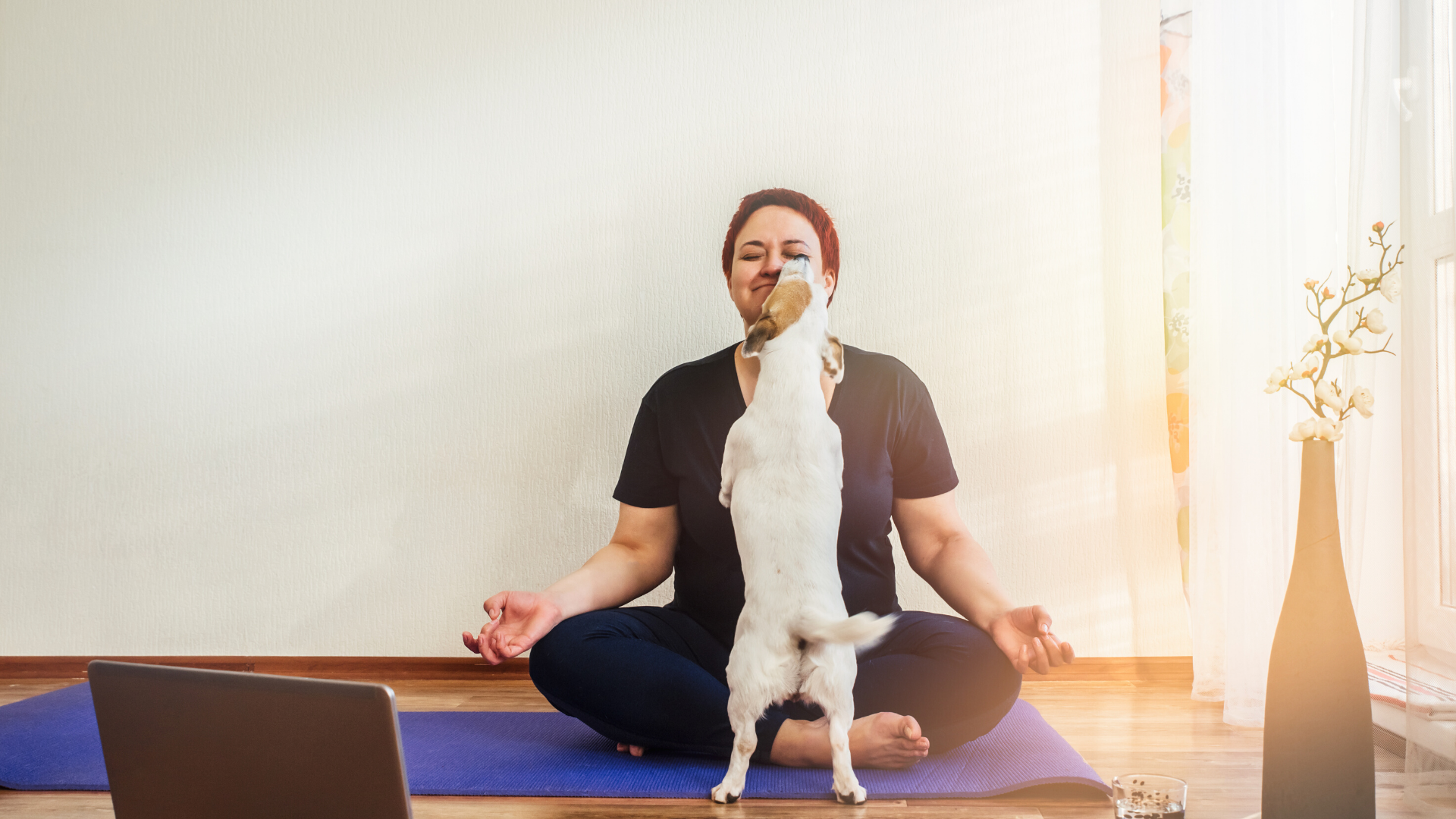 yoga_student_practicing_meditation_with_her_dog_at_home