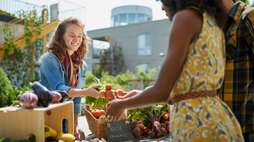 Female gardener selling organic crops in the city to end hidden racism with food